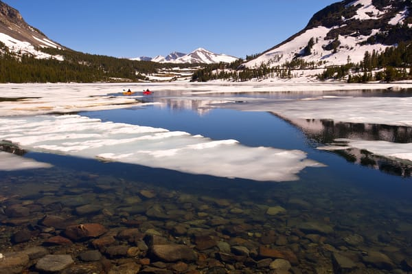 image of kayaks on tioga lake in early summer but it looked like winter