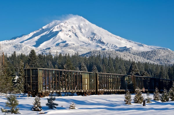 mount shasta snow covered with railcar in the foreground