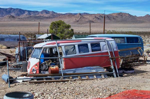 photo of dead vw busse in the california desert