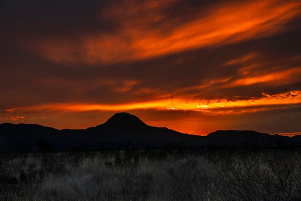 The sun setting behind Santiago Peak in southwest Texas