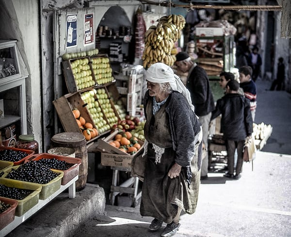 Old Woman Shopping for Fruit in Old City Jerusalem