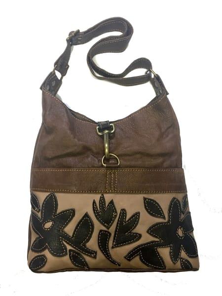 Medium leather shoulder bag with flower motif applique