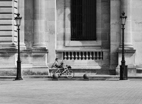 Biker Reading B&W Photograph – Louvre Paris France Photography - Fine Art Prints on Canvas, Paper, Metal & More