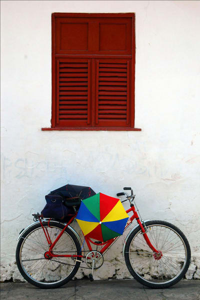 Bike with rainbow umbrella