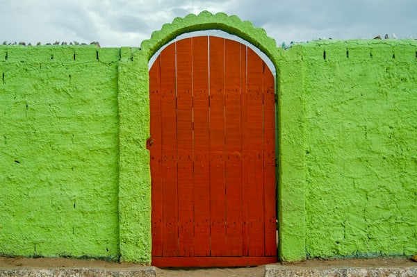 Red door in bright green wall
