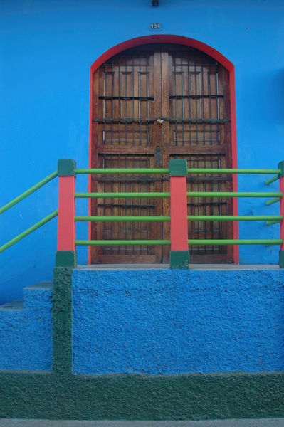 Granada colonial door blue wall