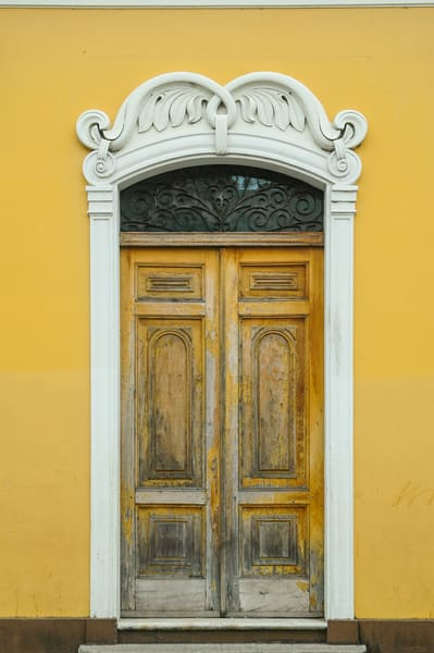 Granada colonial door yellow wall