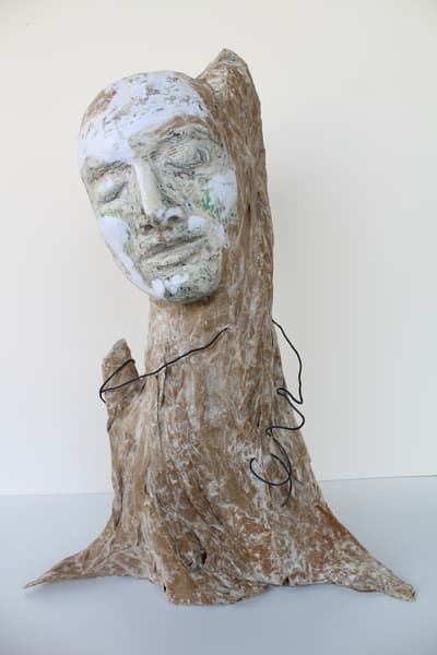 Original papier mache sculpture of a man and tree