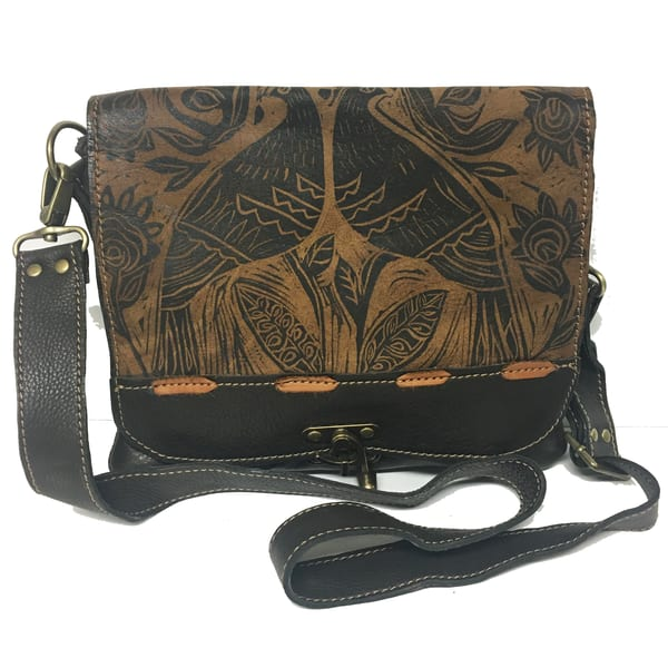 cross-body leather handbag with block print or cut art