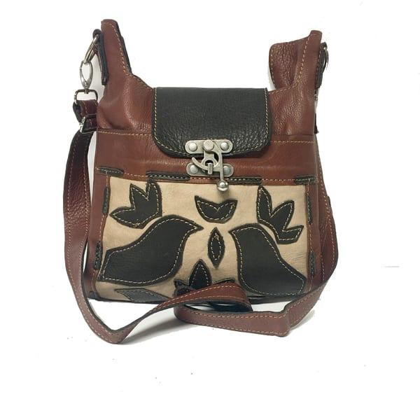 cross-body leather handbag with block print or cut art