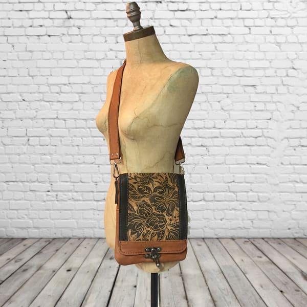 small leather messenger bag with peony print