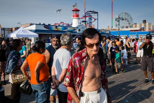 Brooklyn, NY - 17 August 2013. A a man in the crowd on the Coney Island boardwalk.