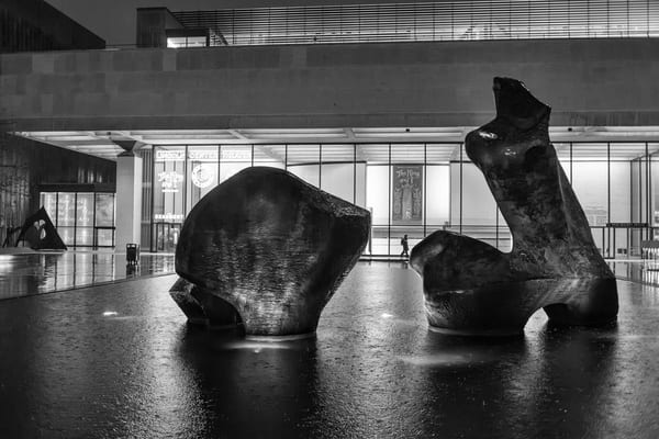 Lincoln Center Theater and the Paul Milstein pool on a rainy December night.