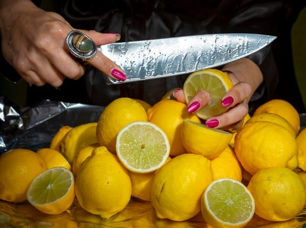 Lemons, knife, nails, juice