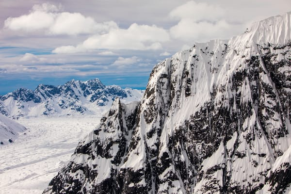 Flying at mountain top level around Alaska's mountain ranges and glaciers