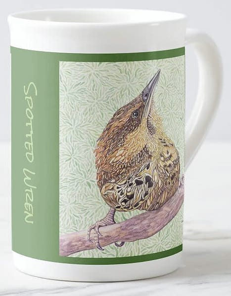 Spotted Wren with green background on fine porcelain cup with art by Judy Boyd.