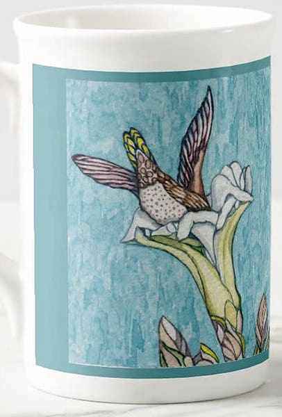 Hummingbird image on fine porcelain cup. Art by Judy Boyd