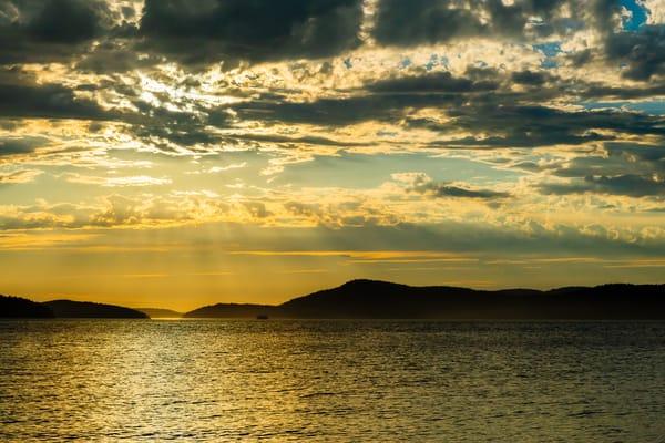 Sun Rays Over the San Juan Islands, Anacortes, Washington, 2016