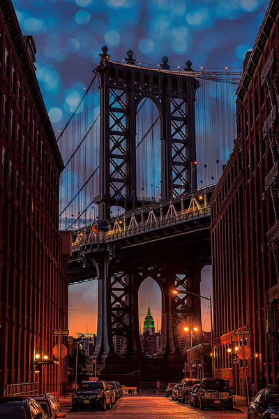 Manhattan Bridge under a decorative, twilight sky.