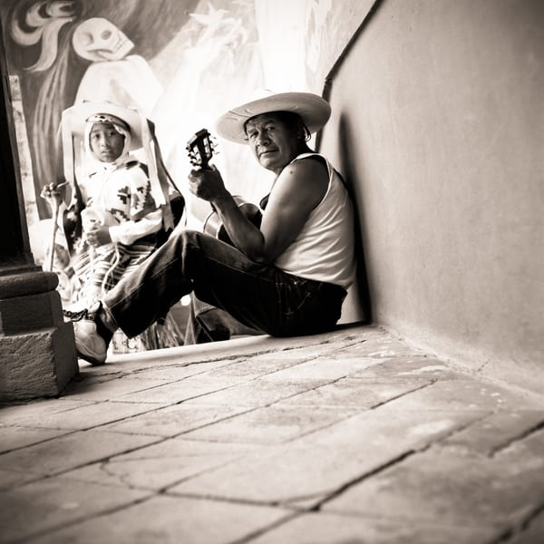A musician playing his guitar in Mexico.