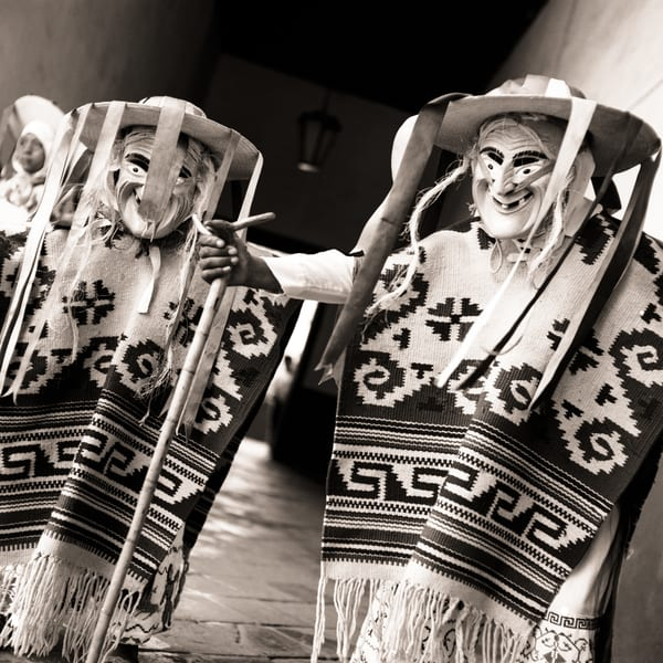 Two masked dancers in Mexico.