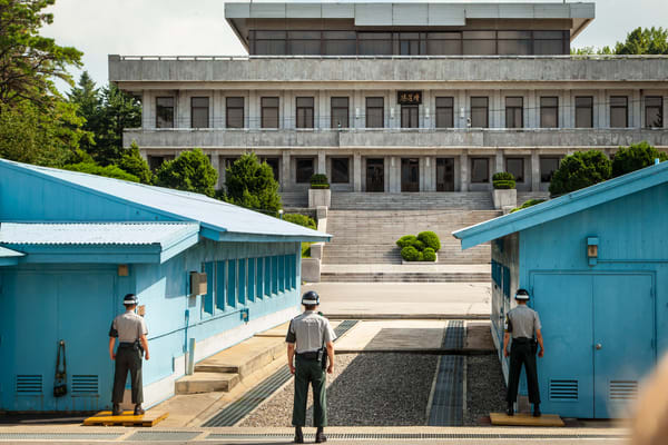 South Korean (ROK) soldiers  stand guard facing Notrh Korea.  This is the area where the leaders of the two countries gather and negotiate their differences.
