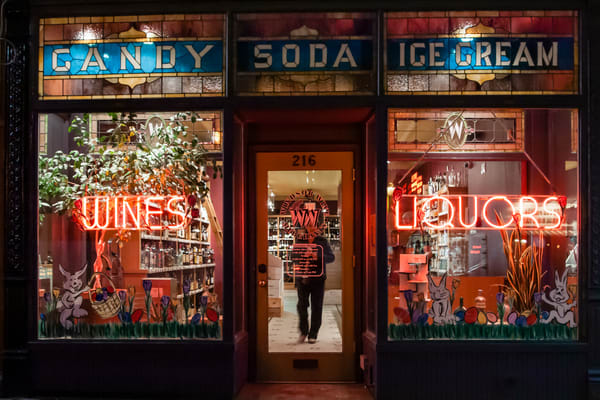 Windsor Wine Merchants, in a former soda shop and candy store, retained the original stained glass widnows advertising candy, soda andicecream.