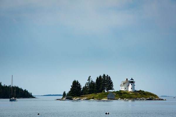 Pumpkin Island, ME -10 August 2014. Pumpkin Island Light, at the northern end of Eggemoggin Reach. The lighthouse is decommissioned, as is in private hands.