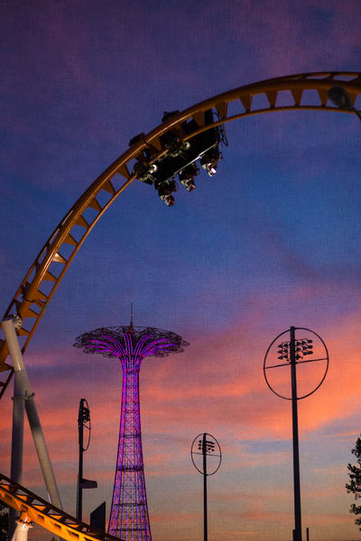 Roller Coaster and upside down riders in Coney Island.