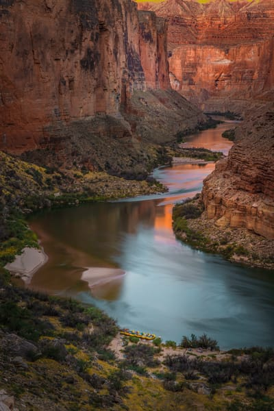 The walls of the of the Grand Canyon reflecting onto the Colorado River.