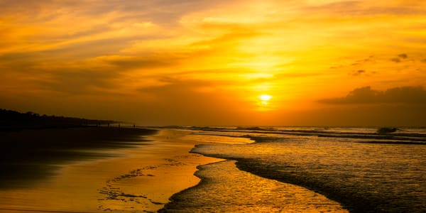 Yellow Sunrise Over Ocean Edge