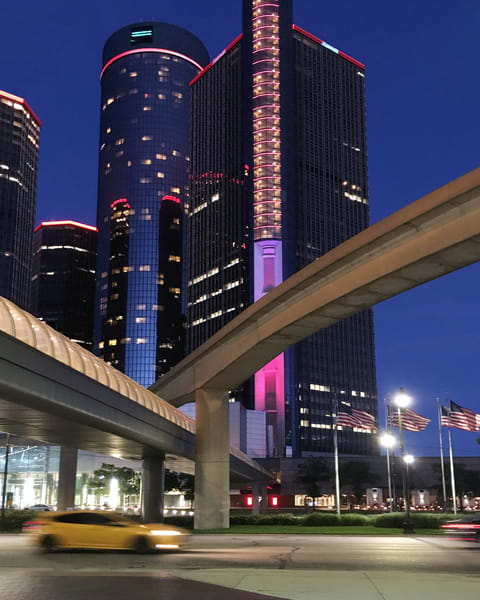 RenCen at night with taxi