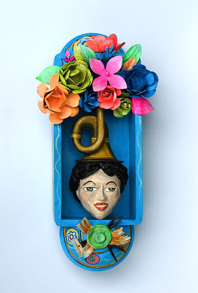 This wall hanging by Karen Rexrode represents the dreams of a gardener, built to resemble Mexican Folk Art with its many colors.