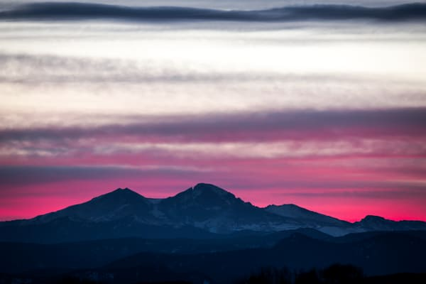 The Purple and Pink light covered the evening with an almost make-believe hue of color over the Frontrange Mountains Longs Peak were sitting in a silhouette sunset.