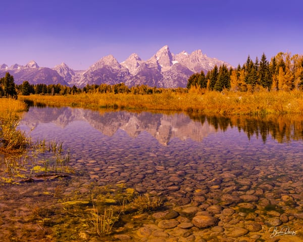 The Snake River and its Rocky Bottom and the Teton Range