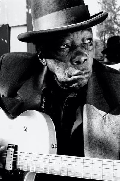 John Lee Hooker on the porch of his house in Redwood City CA