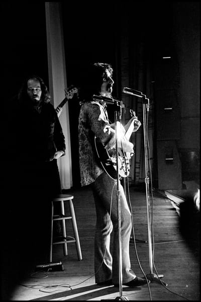 Fall River, Massachusetts - 18 February 1968. Frank Zappa and The Mothers of Invention in performance at the Durfee Theater.. Behind Zappa on stage is Ray Collins.