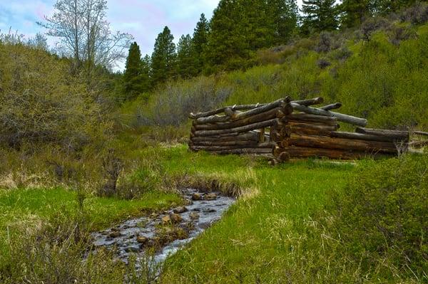 Old Log Cabin by Creek, Kittitas County, Washington, 2011
