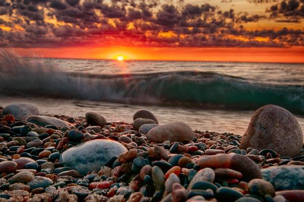 shoreline stones michigan lake sunset