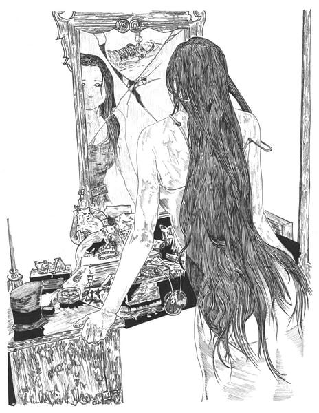 Beautiful girl gazing in the mirror