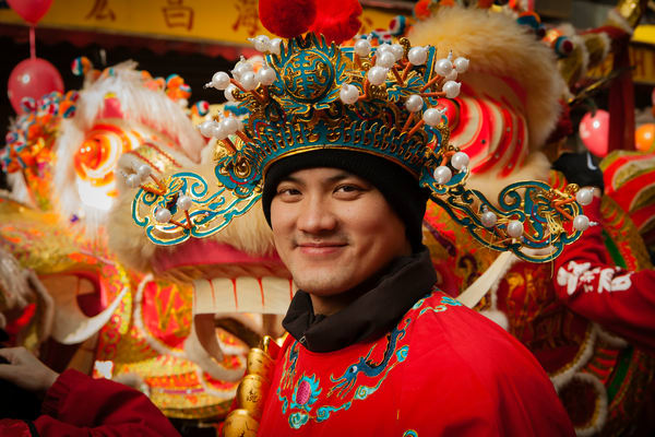 A young man in ornate, traditional costume and headdress.