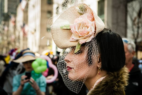 New York, NY - 8 April 2012. A woman in a hat and veil reminiscent of the 1940s in New York City's Easter Parade and Bonnet Festival on Fifth Avenue.