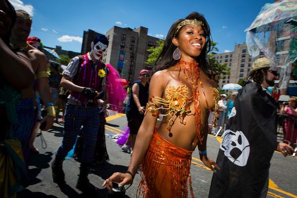 A young woman festooned with sparkly beads in the annual Cpney Island Mermaid Parade.