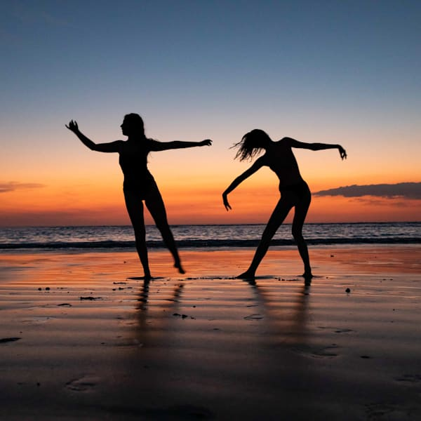 Gift shop including tote bag, pillow and square prints image of two dancers, Dance When You Walk, by Amy Hart