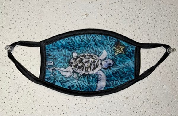 This original mask design by artist Muffy Clark Gill of an albino Green Sea Turtle is reproduced from an original batik painting.