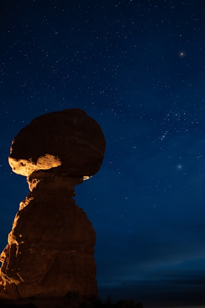 Balanced Rock with Orion and stars in Arches National Park, Moab, Utah USA