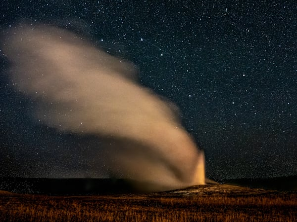 Old Faithful geyser in Yellowstone National Park, erupting at night beneath the big dipper. This is a simgle image with a 20 second exposure.