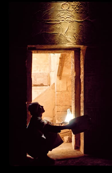"Artifacts on tomb interior at Deir El-Medina ""Thebes"" being lit by use of mirrors to reflect the sunlight deep into the tomb.  Luxor, Egypt"
