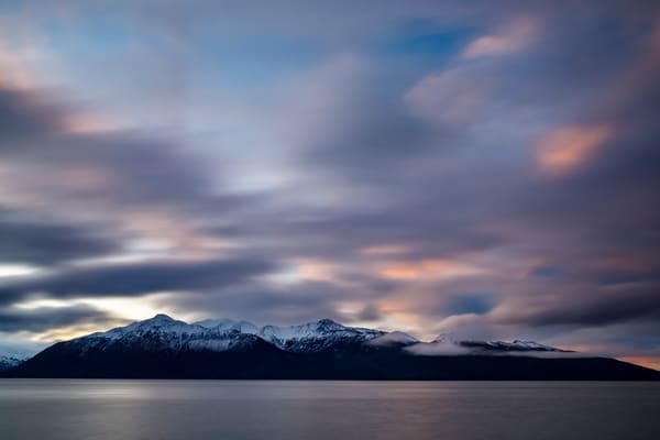 Clouds roll over and past the Kenai Mountains with Turnagain Arm below. Sunrise.  Winter landscape.  December.    Photo by Jeff Schultz/  (C) 2019  ALL RIGHTS RESERVED
