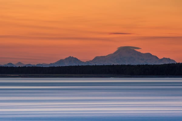Mt. Mckinley, Mt. Foraker and Mt. Hunter are silhouetted against the sky after sunset as seen from Pt. Woronzof in Anchorage, Alaska.  Cook Inlet in foreground.  Summer  Copyright Jeff Schultz / SchultzPhoto.com  ALL RIGHTS RESERVED